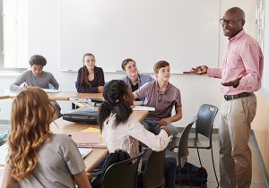 Educator teaching a class of students